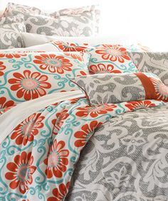 Ideal for a teen's room or guest bed, this floral comforter set will turn a mattress into a masterpiece within moments. There's no guesswork to create a little throw pillow magic—the padded shams and decorative pillows with matching printed accents coordinate perfectly already.