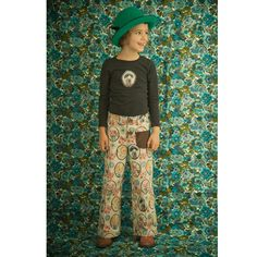 Same MishaLula fabric print, different clothing application. Awesome Liberty-style floral fabric in the background too.