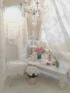 S ℎ a b b y . C ℎ i c corner of room chair & bench , chandelier , lace curtains