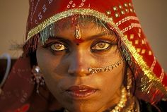 India | Portrait of a Bopa Gypsy, nomadic people of the Rajasthan Desert, Pushkar.  Among the lowest castes are the Bopa and Kalbeliua Gypsies.  In spite of their low status, these beautiful people are proud of their roots and both make their living by performing songs and dances | Image and caption © Jean Philippe Soule