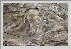 Idea for concrete floor stain- Chitina River, Wrangell St. Elias National Park, Alaska.    The Chitina River, braided and drying up in the fall, creates an array of interesting patterns, Wrangell-St. Elias National Park and Preserve, Alaska - aerial photo of braided river.