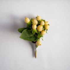 Simple Berry Boutonniere – Pops of Plum