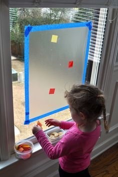 Sticky windows... Contact paper taped up sticky side towards your child. Let your kids put tissue paper squares and make a fun stain glass window!