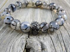 Dragons vein beads and a rhinestone skull focal by WynnesWhimsies, $26.00