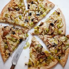 Roasted Chicken and Leek Pizza | Store-bought rotisserie chicken, with its juicy meat, makes a great topping for a fast pizza.