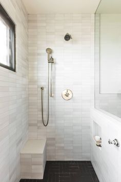 """One thing that didn't require changing was the scale of the shower window, the only source of natural light in the bathroom: """"I felt the scale of the window to the narrowness of the room was right,"""" Barnoon says, """"and the size allowed for some privacy."""" She did replace the actual window with a newer model."""