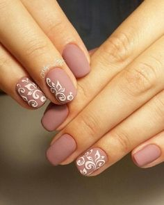 Matte pink winter nail art design. A lovely looking nail art design with pink matte as the base color topped with white nail polish designed as magical leaves.