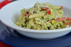 Penne with Broccoli Pesto and Corn -      Salt     4 cups broccoli florets     ½ cup grated Parmesan cheese, plus extra for grating     ½ cup walnuts     ½ cup extra-virgin olive oil     ½ cup packed basil leaves     Ground black pepper     ½ pound bite-size pasta, such as penne     2 ears corn, kernels removed (about 1 cup)