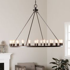 Go beyond the ordinary when you install this chandelier in your living room. This round chandelier features an oiled-bronze finish with decorative light bulbs to illuminate your room. This br Circular Chandelier, Chandelier Chain, Bronze Chandelier, Ceiling Chandelier, Rustic Chandelier, Ceiling Lights, Chandelier Ideas, Chandeliers, Diner Decor