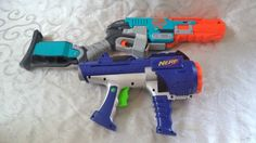 1 Zombie Strike Sledgefire Rifle, 1 in the chamber and 3 for reserve. For your long range shooting. 1 Dart Tag Gun, holds up to 10 darts for shooting rounds of Darts. 2 Great Nerf Guns.