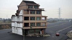 This Chinese house sits in the middle of a brand-new road - no emminent domain in China.