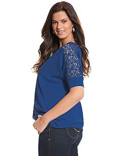 Feminine tee romances your comfort collection with sheer floral lace insets at the shoulders and back. Tapered seaming lends a flattering fit, with a high-low hem for a trendy finish. Banded elbow sleeves. lanebryant.com