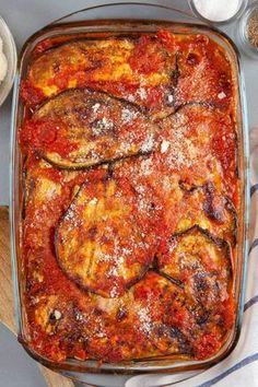 Low Carb Eggplant Parmesan in a glass dish with parmesan cheese.