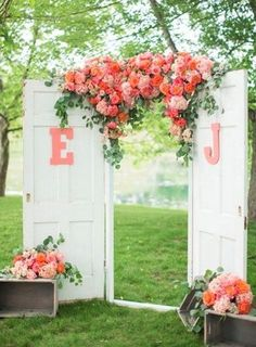 Wedding Backdrop Bright Flowers and White Doors