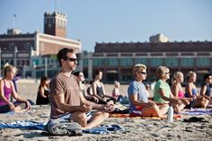 Asanas In The Sand Beach yoga spreads calm up and down the Shore.   Photo by Marc Steiner/Agency New Jersey.