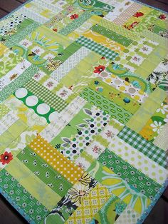 green and yellow quilt--This looks like jelly roll strips made into squares and sewn together.  This could be so quick and easy for a baby quilt.