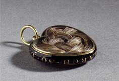 An English gold and enamel commemorative pendant,c.1824; the heart-shaped pendant contains a lock of plaited hair and is inscribed with the initials 'E.D. March 30, 1824'; the hair belonged to Elizabeth Foster, the second wife of the 5th Duke of Devonshire, and the pendant commemorates her death in Rome in 1824, where she was attended to by her stepson, the 6th Duke of Devonshire.