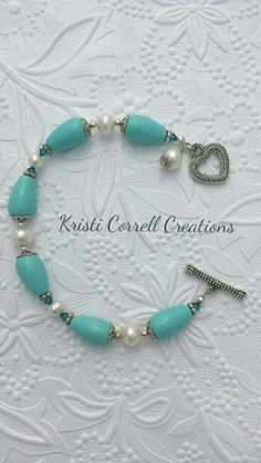 Genuine turquoise and white freshwater pearls with teal Swarovski crystals by Kristi Correll Creations.