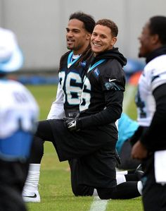 Carolina Panthers cornerback Cortland Finnegan (foreground) jokes with his new teammates during practice on Tuesday.