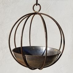 The open cage of the Passage Handmade Globe and Planter is made of durable metal and comes in your choice of available finish. This planter hangs from a hook and is perfect for vines and trailing flowers. Select from available size options. Trailing Flowers, Potted Flowers, Flower Pot Design, Garden Planters, Outdoor Planters, Indoor Outdoor, Garden Spheres, Hanging Planters, Hanging Baskets