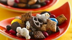 Enjoy this munching treat that's made easily with Chex Mix® dark chocolate snack mix and your favorite treats – blueberries, popcorn and peanut candies. Ready in just five minutes!