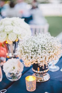 Navy + White wedding - White floral centerpieces against blue linens