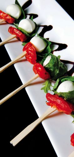 Neat idea... We do the caprese salads on a stick, but with several layers. A lot of times guests only eat the first layer, this is cool bc it's one bite.