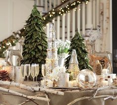 christmas tablescape for a foyer.  Branches could be velcroed to the tablecloth.  I'd probably opt for smaller/thinner ones.  The birch is a nice contrast to the burlap