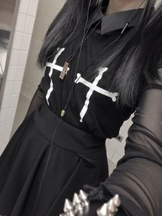 (nu?) goth fashion. bones + crosses. all black. silver spiked bracelet. <3