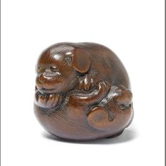 A wood netsuke of two puppies  By Issan