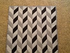 Grey and black herringbone quilt Herringbone Quilt, Baby Quilt Patterns, Hand Quilting, Quilt Making, Wood Wall Art, Baby Quilts, Caravan, Cozy, 3d