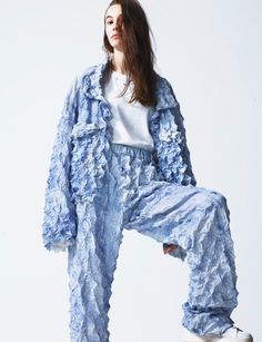 WGSN-Faustine-Steinmetz-Spring-Summer-2015-London-Fashion-Week / Spring/Summer 2015. Denim jackets and jeans appeared in allover 3D shibori puckering, unraveling hemlines, froths of hand plucked denim frays, Frankenstein twisted and skewed seams and most impressively ghostly bonded web structures.