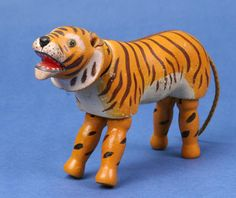 The Schoenhut Tigers    There are five tiger designs known - one regular size glass eyes, two regular size painted eyes, and two reduced size painted eyes. No decal eyes tigers has been seen. The tiger was first produced in 1906.