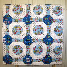 Work Truck Traffic - a handmade baby quilt made of 100% cotton flannel for those little boys who love their trucks.