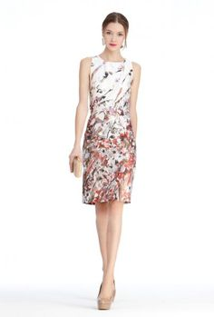 Floral shift dress with embossed silver clutch and rock crystal earrings