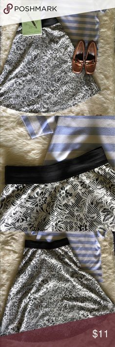 🍓Francesca Collection Black and White skirt🍓 This classic Francesca Collection short will have you looking prim and proper if paired with a blouse, sexy with a crop top or cool with a retro band tee. The band is a thick elastic so it won't budge and the a-line is absolutely perfect. Comment with any questions and as always bundles of 3+ are 15% off!! Francesca's Collections Skirts A-Line or Full