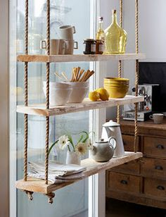 A lovely hanging shelving unit for plants and decorative glass.  I see it swinging wildly from side to side after hearing a loud crash and the sound of breaking glass.