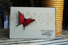 This was my SIL's b'day card for this year (2014). I stamped the Gina K butterfly onto some suede, red CS & heat embossed it. The pattern behind it is just stamped in Versamark ink & then it's scored above & below it to give a little more wow.