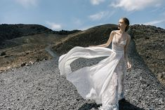 ATHENA: Our off white A-line dress made with Chantilly lace, decorated with a Chiffon skirt