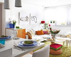 A refurbished 40 square meter apartment with a colorful interior/// I love everything about this space. the art too.