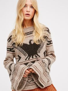 Heirloom Thunderbird Pullover   Comfy knit sweater with a cute nature and tribal-inspired bird and arrows print. Features flared sleeves and a slightly cropped, swingy silhouette.