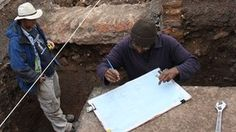 Archaeologist Mathew Morris (left) and colleague record Richard III's grave.