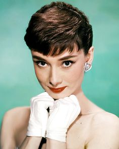 Hairstyles in the 1950s and 1960s veered between the flip, structured curls, the beehive, and everything in between. The one constant element? The short, above-the-brow fringe famously worn by Audrey Hepburn.