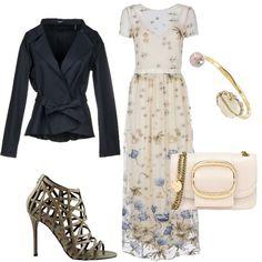 09fa49f0b220 Delizioso abito lungo con tulle ricamata in fantasia floreale