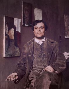 Amedeo Modigliani in his studio with portraits of Beatrice Hastings and Raymond Radiguet, photographed by Paul Guillaume in 1915. Colorized.