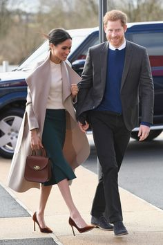 Markle switched up her look today, wearing a green midi skirt instead of her more usual trousers. Her coat is Mackage, her bag is from Charlotte Elizabeth, her top is Victoria Beckham (her close friend Beckham must be thrilled about this), and her shoes are Jimmy Choo. The outfit is worth over $1,606, and Harry and Markle reportedly paid for all of it.