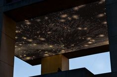 Leo Villareal's newest work Cosmos lights up the underside of the Herbert F. Johnson Museum of Art's 5th floor Tuesday at twilight above the second floor sculpture court. The display uses 12,000 energy efficient computer driven light-emitting diodes to create an ever changing display.