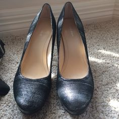 Calvin Klein Kendall platform pumps In great condition I'm not sure I ever wore them but once! Shades of black and silver.  Sexy!! Calvin Klein Shoes Heels