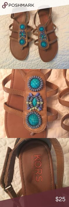 Michael Kors beaded sandals Michael Kors blue/aqua beaded brown strappy sandals. In excellent condition, worn only a handful of times. Very comfortable. Michael Kors Shoes Sandals