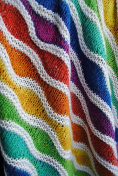 knitted rainbow goodness!  HOW I LOVE THIS.  I need it to live with me to make my legs warm on winter nights and to sit on for autumn evenings, picnic on inthe summer.  Please come and live with me! Jeni